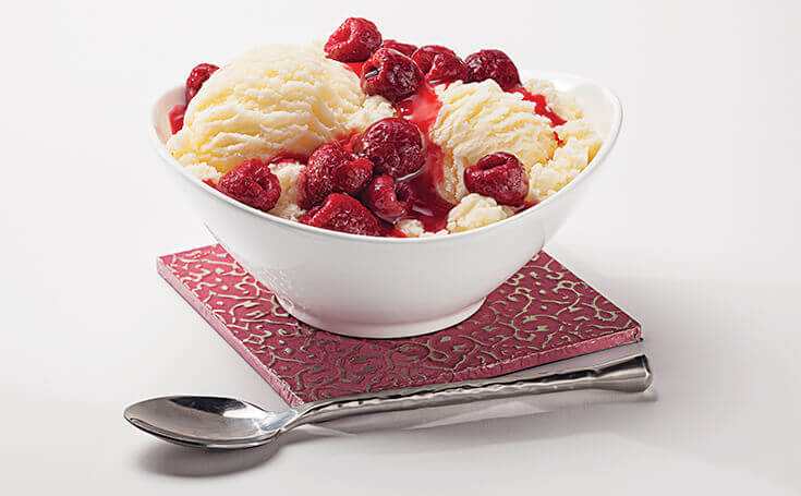 Raspberries on Ice Cream Image